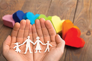 Kalmer Counselling - family in hands